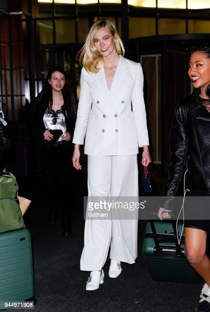 Karlie Kloss wears all white on April 11 2018 in New York City