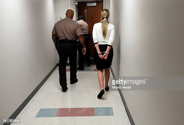 Karlie Tomica charged in the DUI manslaughter of 49yearold chef Stefano Riccioletti in South Beach on January 28 is led away down a back corridor in...