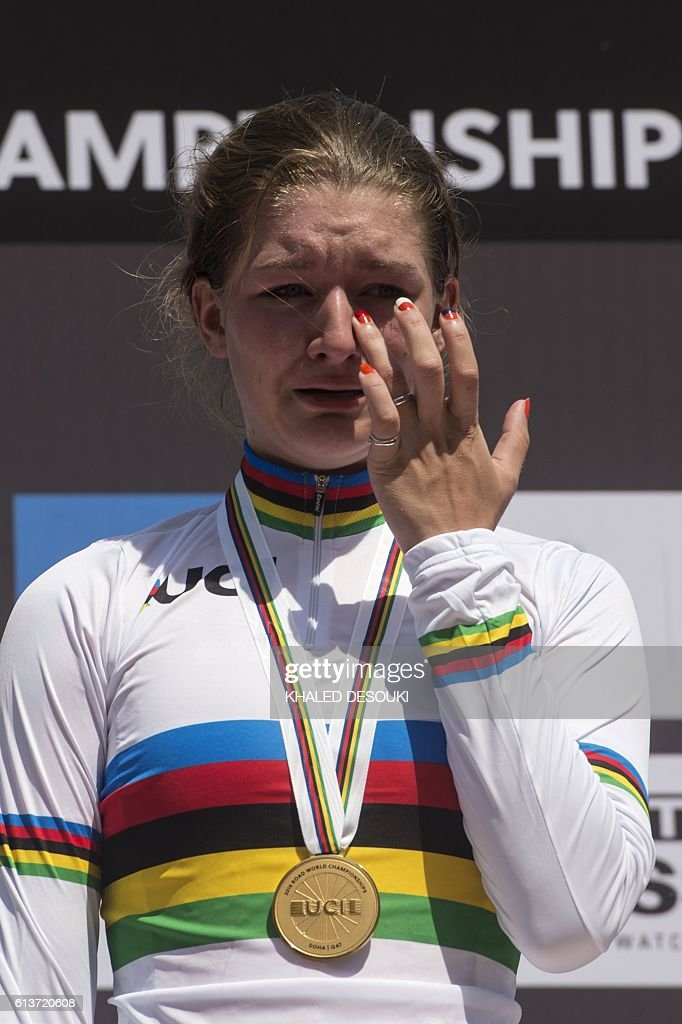 Karlijn Swinkels of the Netherlands reacts after receiving her gold medal at the end of the women's junior individual time trial event as part of the 2016 UCI Road World Championships on October 10, 2016, in the Qatari capital Doha. / AFP / KHALED