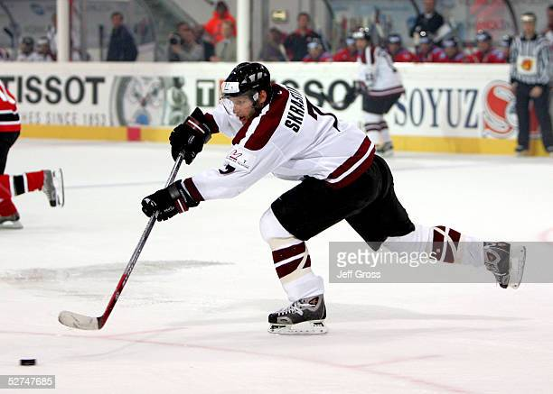 Karlis Skrastins of Latvia takes a shot against Canada in the IIHF World Men's Championships preliminary round game at the Olympic Hall on April 30...