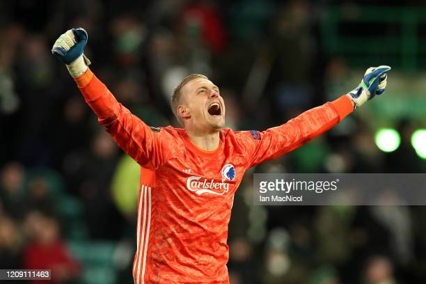 KarlJohan Johnsson of FC Copenhagen celebrates his sides third goal during the UEFA Europa League round of 32 second leg match between Celtic FC and...