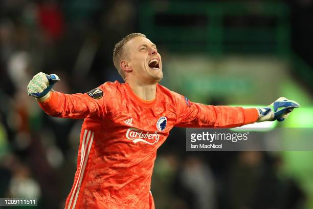 Karl-Johan Johnsson of FC Copenhagen celebrates his sides third goal during the UEFA Europa League round of 32 second leg match between Celtic FC and...