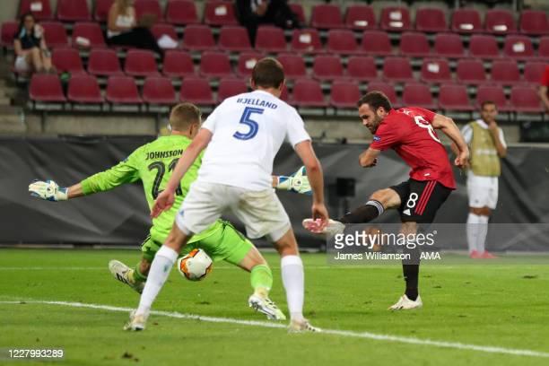 Karl-Johan Johnsson of FC Copenhagen saves from Juan Mata of Manchester United during the UEFA Europa League Quarter Final between Manchester United...