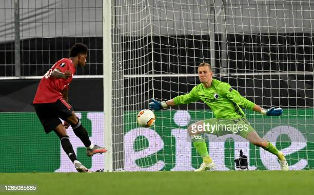 Karl-Johan Johnsson of FC Kobenhavn saves a shot from Marcus Rashford during the UEFA Europa League Quarter Final between Manchester United and FC...