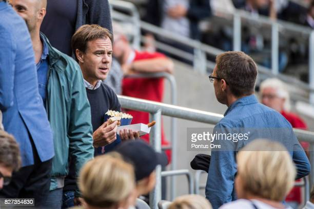 KarlJohan Persson chief executive officer and president of the fashion company Hennes Mauritz seen on the VIPstand eating popcorn and hotdog before...