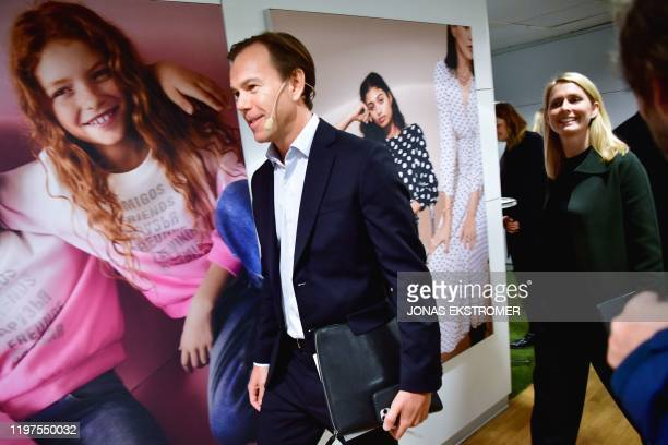 KarlJohan Persson current CEO of Swedish clothing retail giant Hennes and Mauritz and the company's designated CEO Helena Helmersson arrive for a...