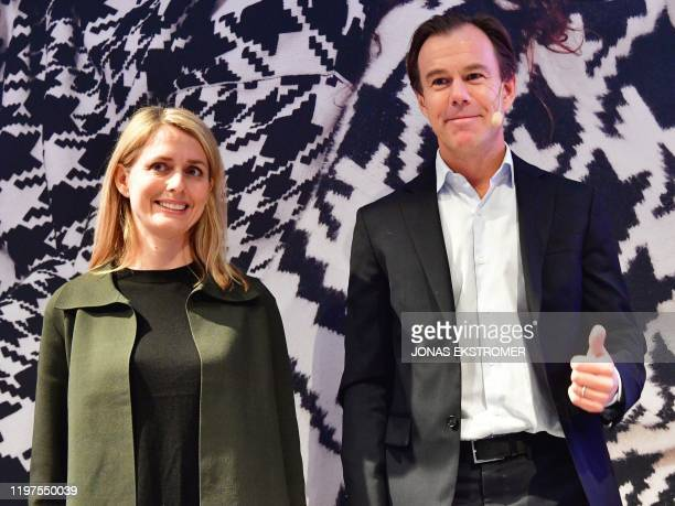 Karl-Johan Persson , current CEO of Swedish clothing retail giant Hennes and Mauritz , and the company's designated CEO Helena Helmersson pose as...