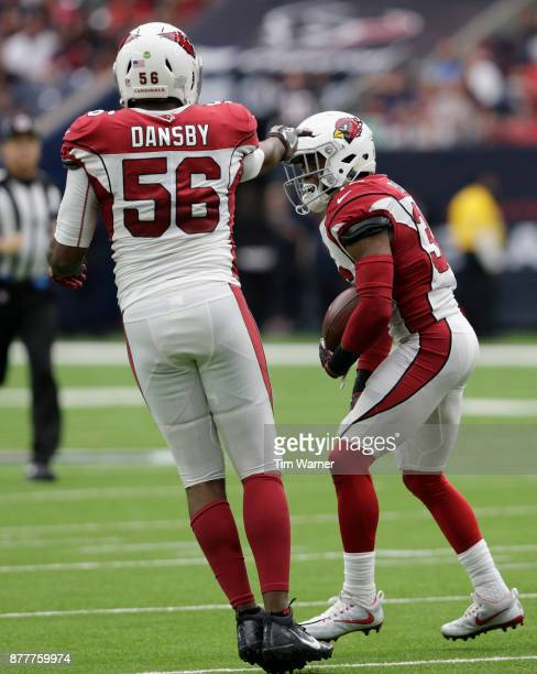 Karlos Dansby of the Arizona Cardinals congratulates Budda Baker after an interception in the first half against the Houston Texans at NRG Stadium on...