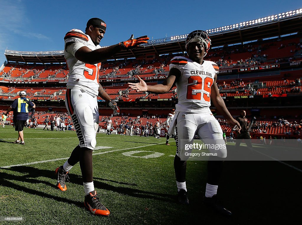 Karlos Dansby #56 of the Cleveland Browns celebrates a 28-14 win over the Tennessee Titans with Duke Johnson Jr. #29 at FirstEnergy Stadium on September 20, 2015 in Cleveland, Ohio.
