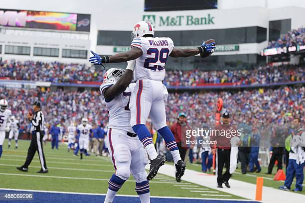 Karlos Williams of the Buffalo Bills celebrates his touchdown against the Indianapolis Colts with John Miller of the Buffalo Bills during the first...
