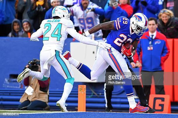 Karlos Williams of the Buffalo Bills makes it into the end zone for a touchdown in front of Brice McCain of the Miami Dolphins during the fourth...