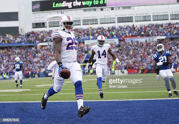 Karlos Williams of the Buffalo Bills runs for a touchdown against the Indianapolis Colts during the first half at Ralph Wilson Stadium on September...