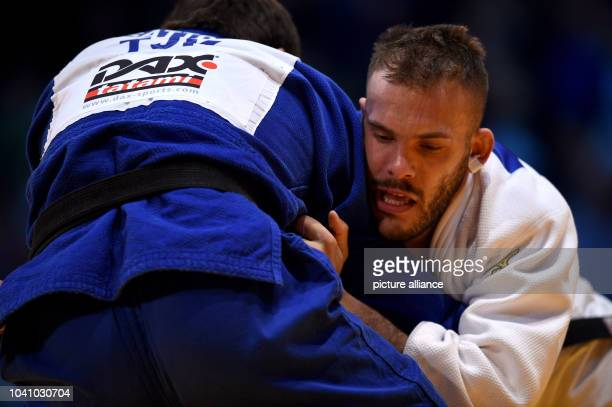 KarlRichard Frey and Abdulvakhov Sattorov in action during the men's up to 100 kg body weight competition at the Judo Grand Prix in the Mitsubishi...