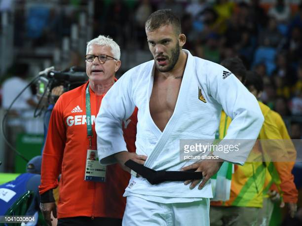 KarlRichard Frey of Germany and German coach Detlef Ultsch during the fight against Miklos Cirjenics of Hungary during the Men 100 kg Elimination...