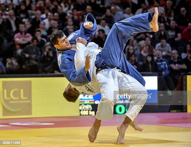 KarlRichard Frey of Germany hurls Elmar Gasimov of Azerbaijan high into the air in an attempt to score ippon with uranage during extra time Gasimov...