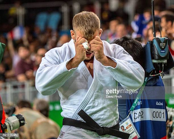 KarlRichard Frey of Germany leaves the mat in tears after losing u100kg bronze medal contest Cyrille Maret of France during day 6 of the 2016 Rio...