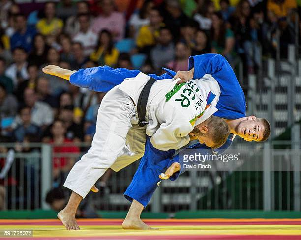 Karl-Richard Frey of Germany throws Miklos Cirjenics of Hungary for an ippon in extra time to win their u100kg contest during day 6 of the 2016 Rio...