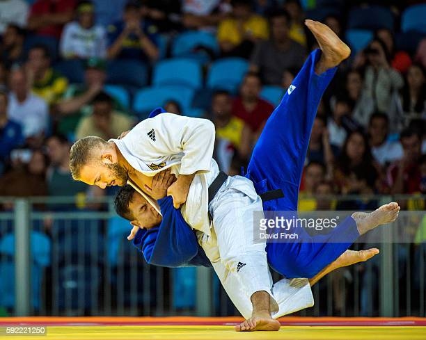 KarlRichard Frey of Germany throws S Yan Niang Soe of Myanmar for an ippon as Frey advanced to the u100kg quarterfinal during day 6 of the 2016 Rio...