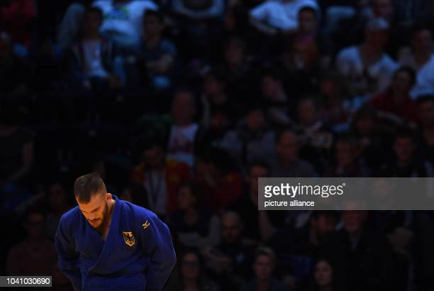 KarlRichard Frey reacts after losing against Michael Korrel during the men's up to 100 kg body weight competition at the Judo Grand Prix in the...