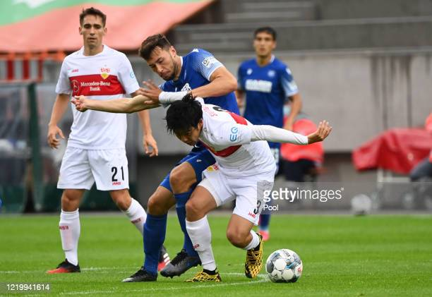 Karlsruhe's Lukas Frode battles for possession with Stuttgart's Wataru Endo during the Second Bundesliga match between Karlsruher SC and VfB...