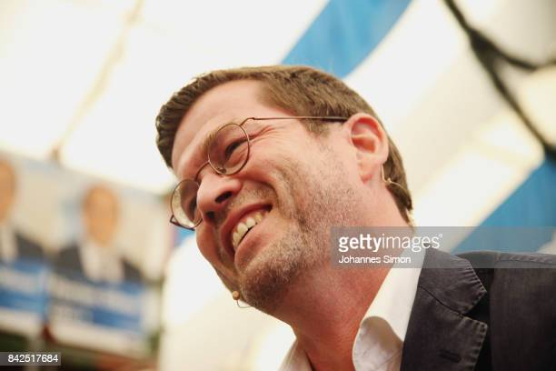 KarlTheodor zu Guttenberg of the Christlich Soziale Union looks on at the Gillamoos amusement fair on September 4 2017 in Abensberg Germany...