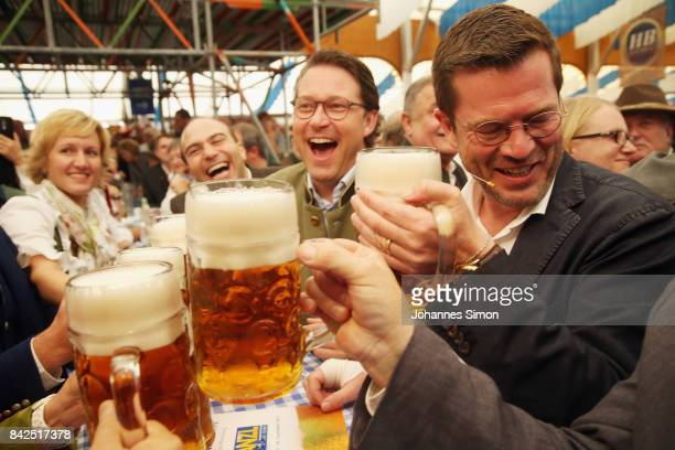 KarlTheodor zu Guttenberg of the Christlich Soziale Union sips a beer in a fest tent beside of CSU general secretary Andreas Scheuer at the Gillamoos...