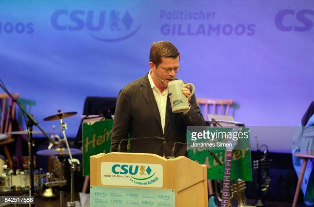 KarlTheodor zu Guttenberg of the Christlich Soziale Union sips a beer in a fest tent at the Gillamoos amusement fair on September 4 2017 in Abensberg...