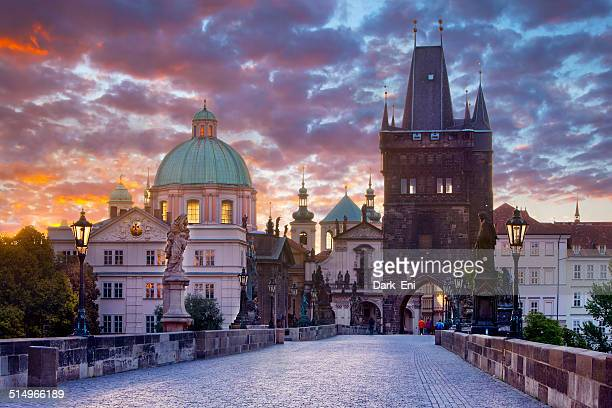 karluv most (charles bridge) early in the morning - charles bridge stock photos and pictures