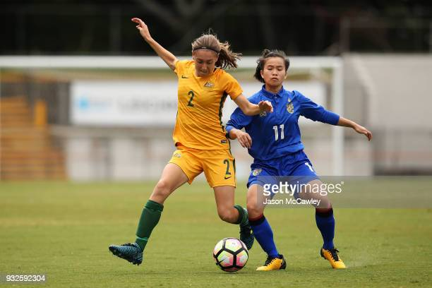 Karly Roestbakken of Australia is challenged by Anuthida Malasri of Thailand during the International match between the Young Matildas and Thailand...