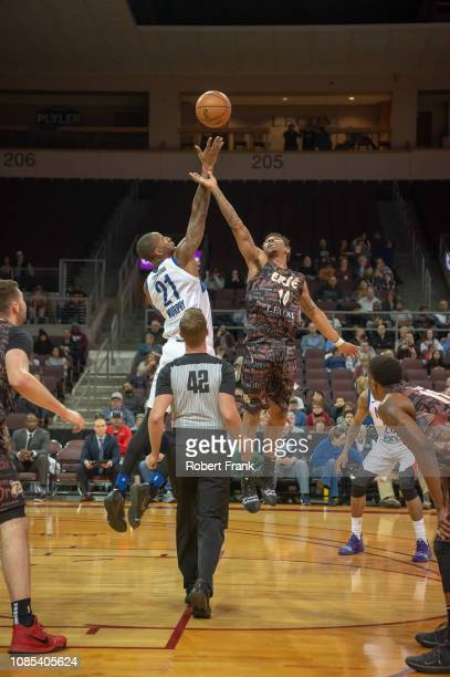 Karmari Murphy of the Long Island Nets wins the jump ball against Jaylen Adams of the Erie BayHawks during an NBA GLeague game on January 19 2019 at...
