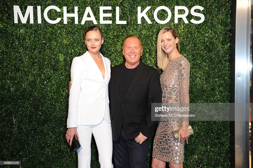 Karmen Pedaru, Michael Kors and Carmen Kass attend Michael Kors To celebrate Milano opening on December 4, 2013 in Milan, Italy.