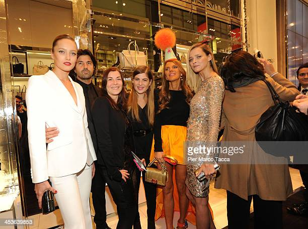Karmen Pedaru Riccardo Ruini guests Anna Dello Russo and Carmen Kass attend Michael Kors To celebrate Milano opening on December 4 2013 in Milan Italy