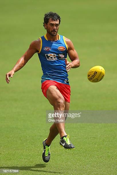 Karmichael Hunt kicks during a Gold Coast Suns AFL training session at Metricon Stadium on February 20 2013 in Gold Coast Australia