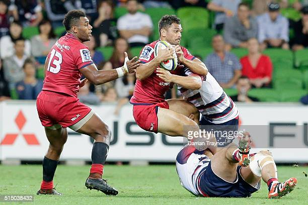 Karmichael Hunt of the Reds is tackled during the round three Super Rugby match between the Rebels and the Reds at AAMI Park on March 12 2016 in...