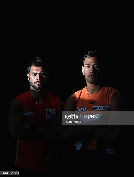 Karmichael Hunt of the Suns and Israel Folau of the Giants pose ahead of tomorrow's first AFL match between the Greater Western Sydney Giants and the...