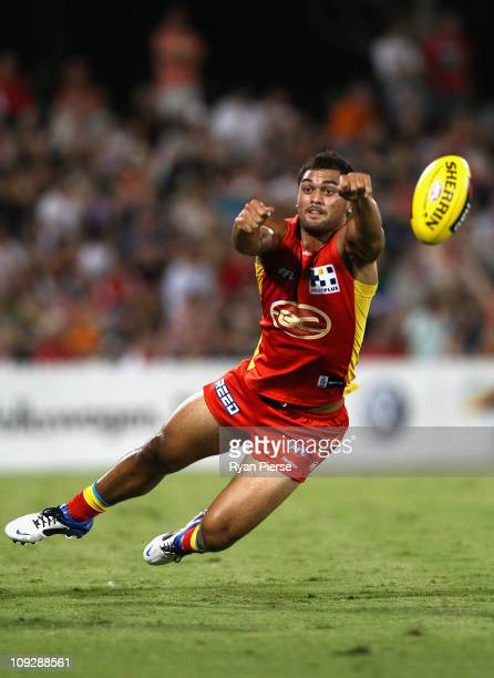 Karmichael Hunt of the Suns dives for the ball during the Pool Five NAB Cup round one AFL match between the Sydney Swans and the Gold Coast Suns at...
