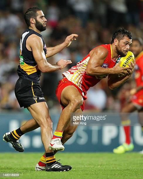 Karmichael Hunt of the Suns marks in the final seconds before kicking the match winning goal after the final siren during the round 16 AFL match...