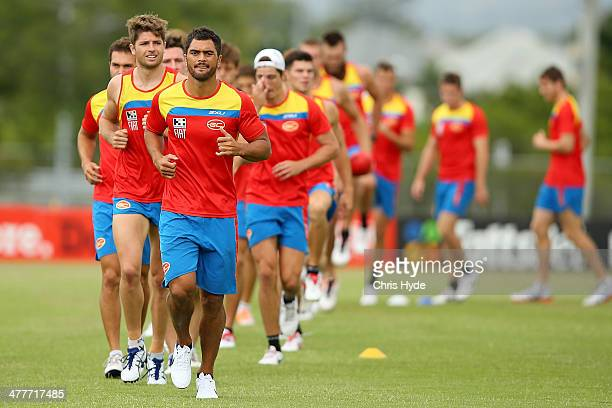 Karmichael Hunt runs during a Gold Coast Suns AFL training session at Metricon Stadium on March 11 2014 in Gold Coast Australia