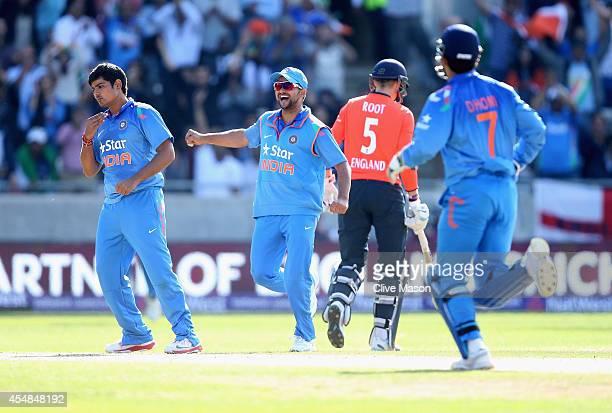 Karn Sharma of India celebrates dismissing Joe Root of England during the NatWest International T20 2014 match between England and India at Edgbaston...