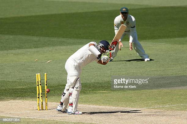 Karn Sharma of India is bowled out by Peter Siddle of Australia during day four of the First Test match between Australia and India at Adelaide Oval...