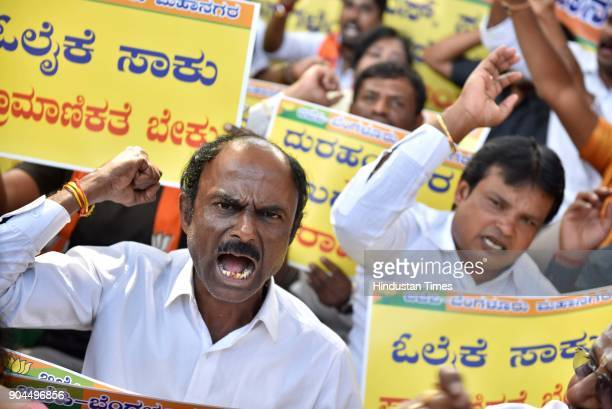 Karnataka BJP activists protesting against the Karnataka chief minister Siddaramaiah's alleged terrorist comment on BJP and RSS on January 13 2018 in...
