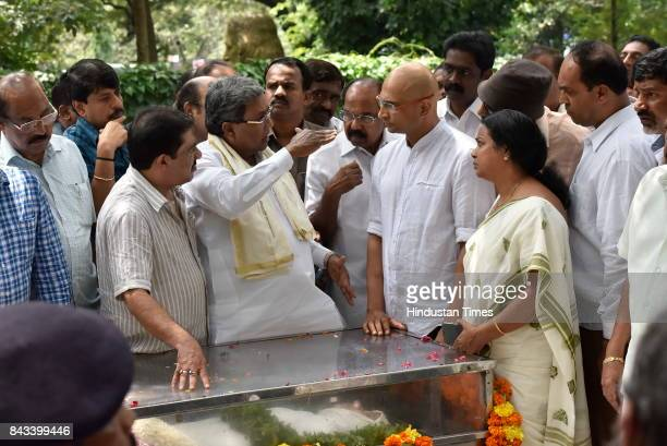 Karnataka Chief Minister Siddaramaiah speaks to Indrajit brother of the slain journalist Gauri Lankesh as her mortal remains kept at Town Hall on...