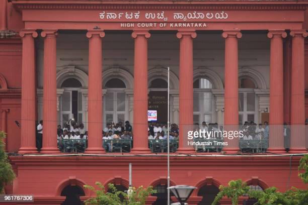 Karnataka High Court staffs watching the swearingin ceremony of HD Kumarswamy as the 24th Chief Minister of Karnataka from the High Court balcony on...