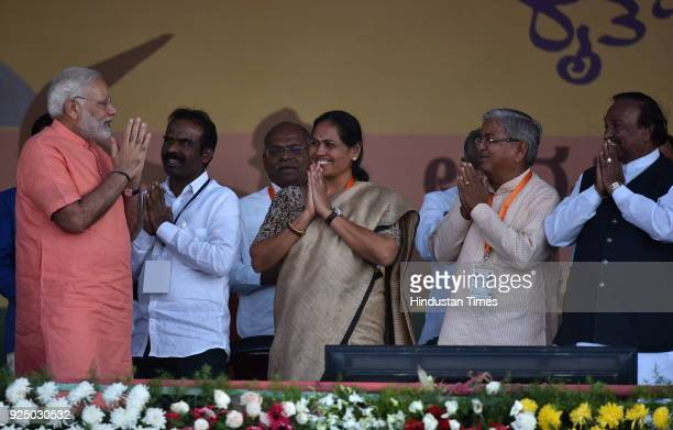 Karnataka state BJP leaders welcoming Prime Minister Narendra Modi as other leaders looks on during Farmer's Convention on February 27 2018 in...