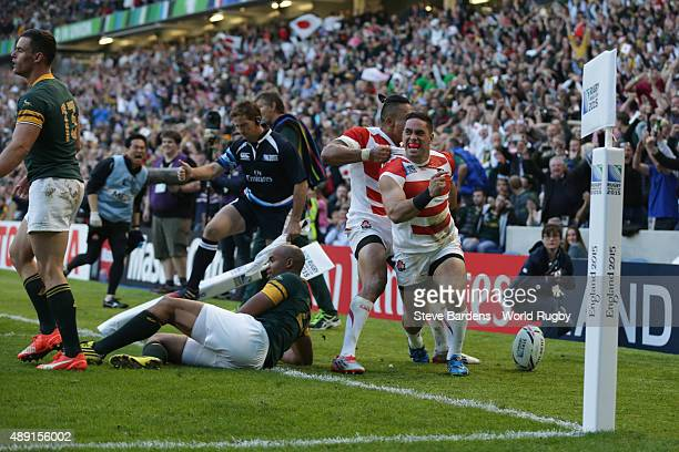 Karne Hesketh of Japan celebrates scoring the winning try during the 2015 Rugby World Cup Pool B match between South Africa and Japan at Brighton...