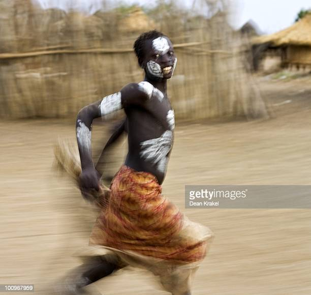Karo boy chases after a Land Cruiser as it leaves the village of Kolcho above the Omo River The Karo with about 1500 are one of the Omo regions most...