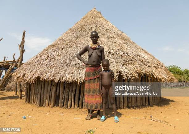 Karo tribe mother with her son called Lale who was born mingi but was saved after the tradition of killing them ended in the village Omo valley...