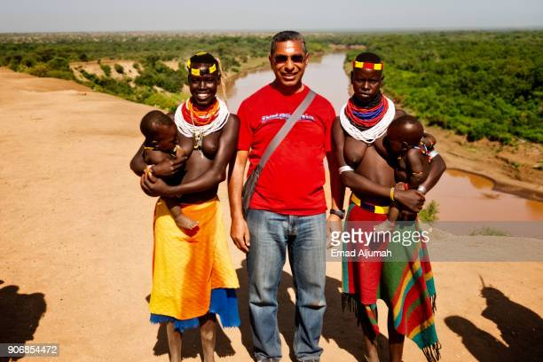 karo tribe women in korcho village posing with tourist, omo valley, ethiopia - eastern african tribal culture stock photos and pictures