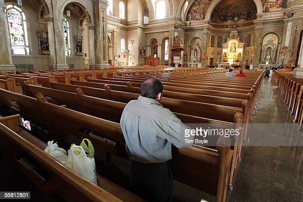 Karol Debicki prays in Archdiocese of Chicago's St Hyacinth Catholic Basilica September 27 2005 in Chicago Illinois The Archdiocese of Chicago has...