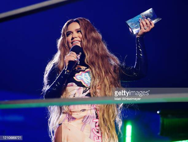 Karol G accepts award for 'Artista Más Escuchada' onstage during the 2020 Spotify Awards at the Auditorio Nacional on March 05, 2020 in Mexico City,...